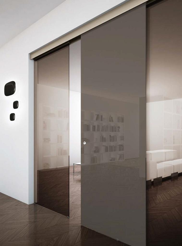 Porta in vetro a tre ante scorrevole esterno muro | Serramenti Tomasini
