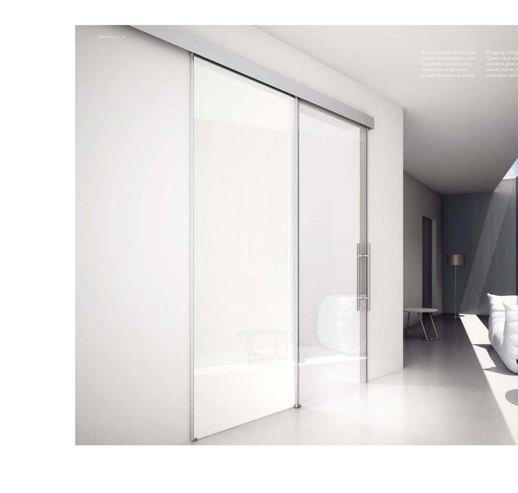 Porta in vetro scorrevole esterno muro | Serramenti Tomasini